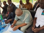 From left: C.E.C Migori, D.A SDF&B.E & Director Acquaculture signing the handing over documents (not certificates).