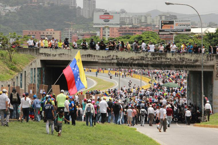 Protesters closed a highway in Caracas while participating in the event called The mother of all protests in Venezuela against Nicolas Maduro government in 2017.