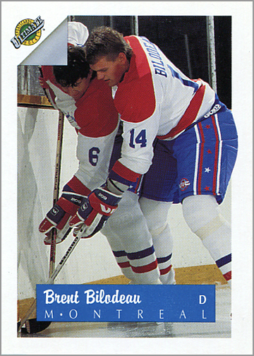 Either Brent Bilodeau is a two-headed monster, or he's fighting for the puck with a teammate.