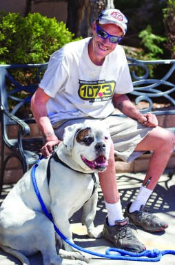Titan, a 140-pound American bulldog, is described as 'super-gentle' by his owner, Lester Strawhecker. (Chieftain photo by Chris McLean)