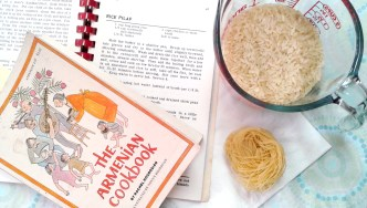 Cookbooks, measuring cup of rice, and vermicelli