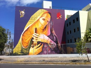 While it may seem like the economy needs a guardian angle like this mural from the 'Los Muros Harblan' international urban art festival - facing reality is much more important.