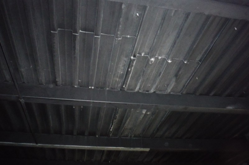 Ceiling is corregated steel exposed interior with tar paper on exterior.