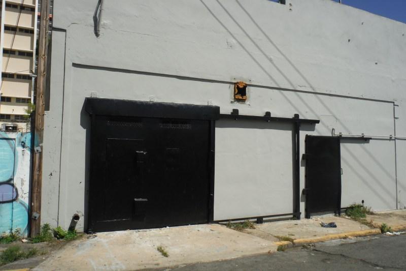 """Garage door on Calle Santa Ana has 7'5"""" clearance.  Main door slides with additional door inset."""