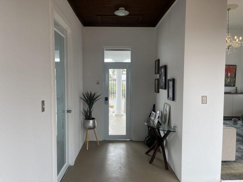 Entry with master bedroom door to left.