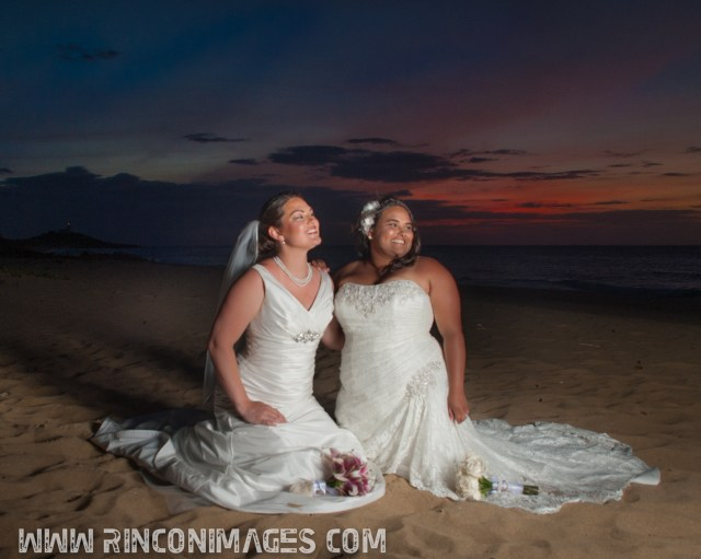 LGBT couple sitting on the beach during a destination wedding in Puerto Rico.