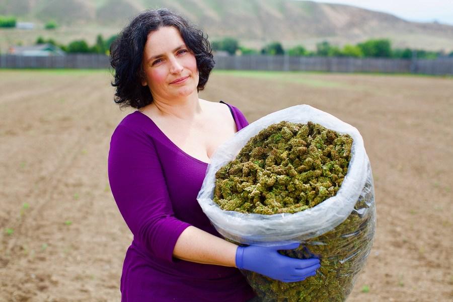 Jade Stefano holds bag of Puffin Farm cannabis