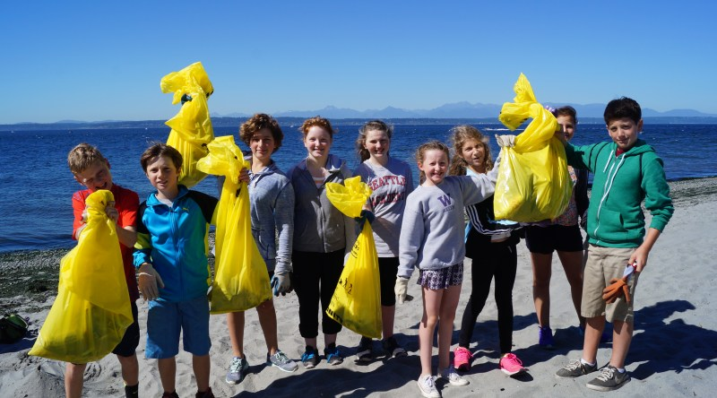 Seattle Academy students with trash collected at Golden Gardens.