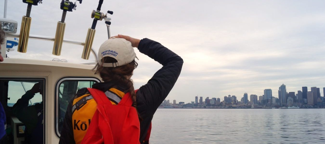 A volunteer looks out at Elliott Bay on a boat patrol.