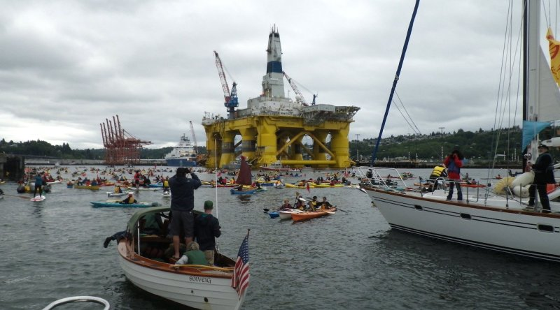 Kayaktivists protest Shell Oil's drilling rig, the Polar Pioneer, while it is moored at the Port of Seattle.