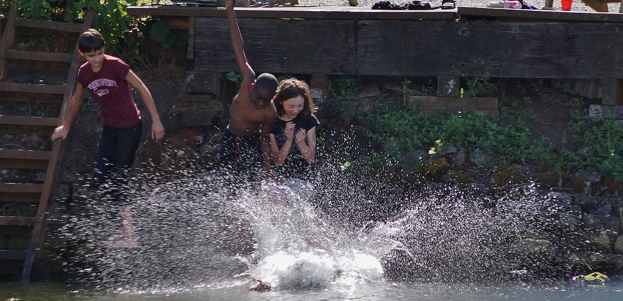 Children swim in the river during the annual Duwamish River Festival.