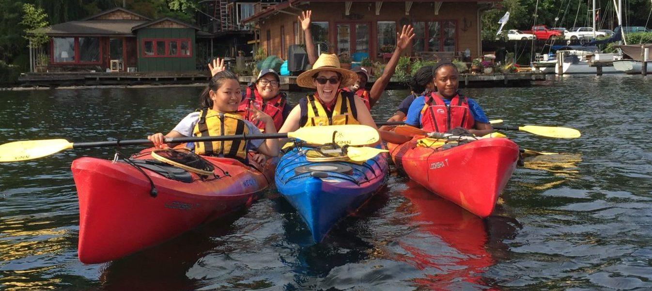 Volunteers on the water during kayak patrol.