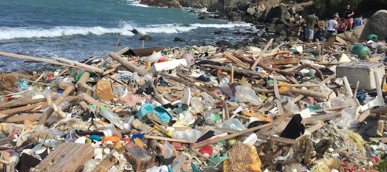 Plastic debris coats a beach in Hong Kong, nicknamed 'Garbage Bay'.