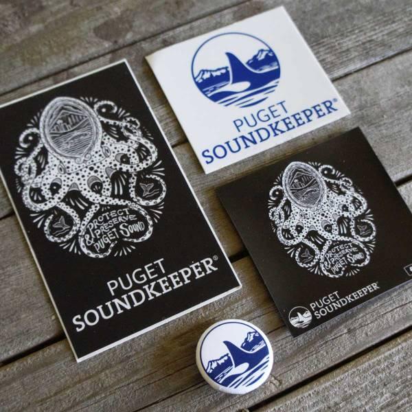 Puget Soundkeeper swag: black-white octopus sticker, blue-white orca logo sticker, orca logo pin, and black octopus magnet