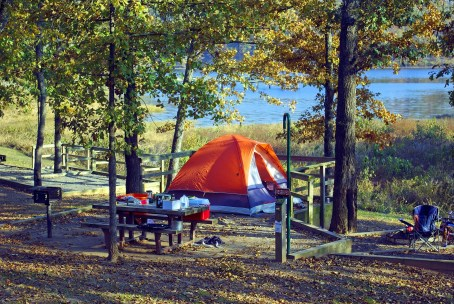 tent at a campsite overlooking a lake