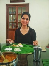 A traditional home cooked vegetarian meal served on a banana leaf