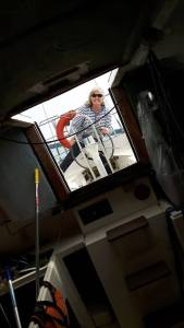 Author Elaine McDivitt amusingly steering boat