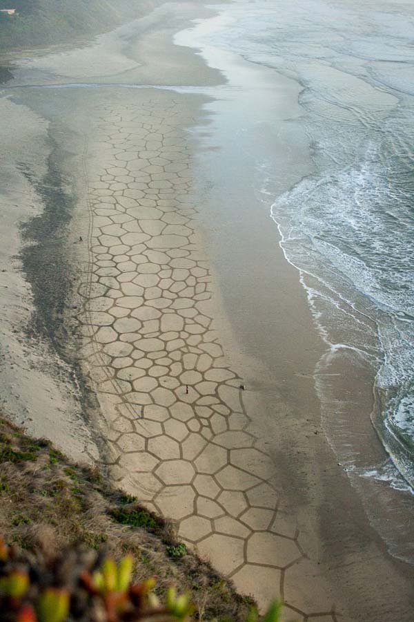 According to Andres, it only takes a couple of hours once the tide is low enough to create the designs.