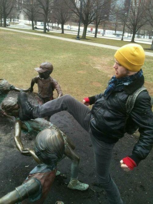 The 30 Most Inappropriate Poses With Statues Of All Time