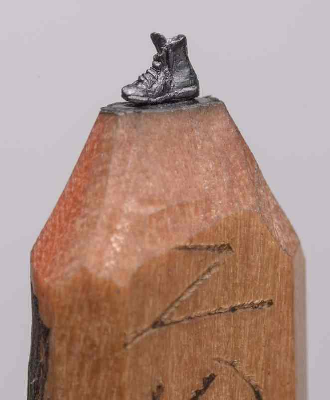Artist carves unbelievably intricate graphite sculptures