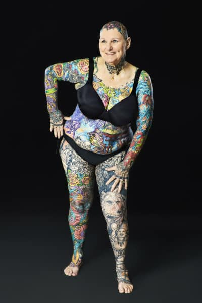 nude woman covered in tattoos