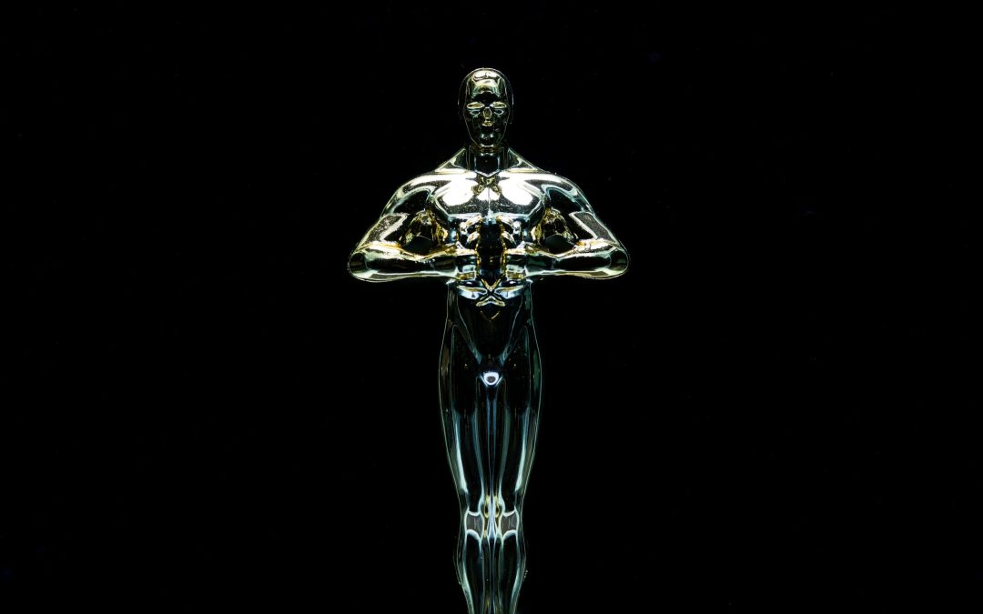 Oscar trophy against black background