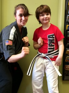 9-year-old Sage (right) with her karate teacher