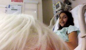 Isabella Antoun, 13, glows during her visit with Hank.