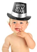Adorable ten month old baby boy wearing a Happy New Year hat.