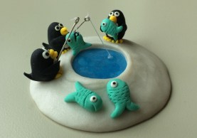 Nina designed this miniature scene of penguins. She created clay art for Dr. Ellenbogen 12 years ago to thank him for saving her life.