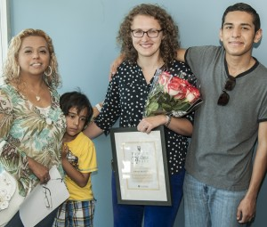 Jo Ristow (holding flowers) with Victoria Montalvo and her sons, Amado (in yellow) and Jairo.