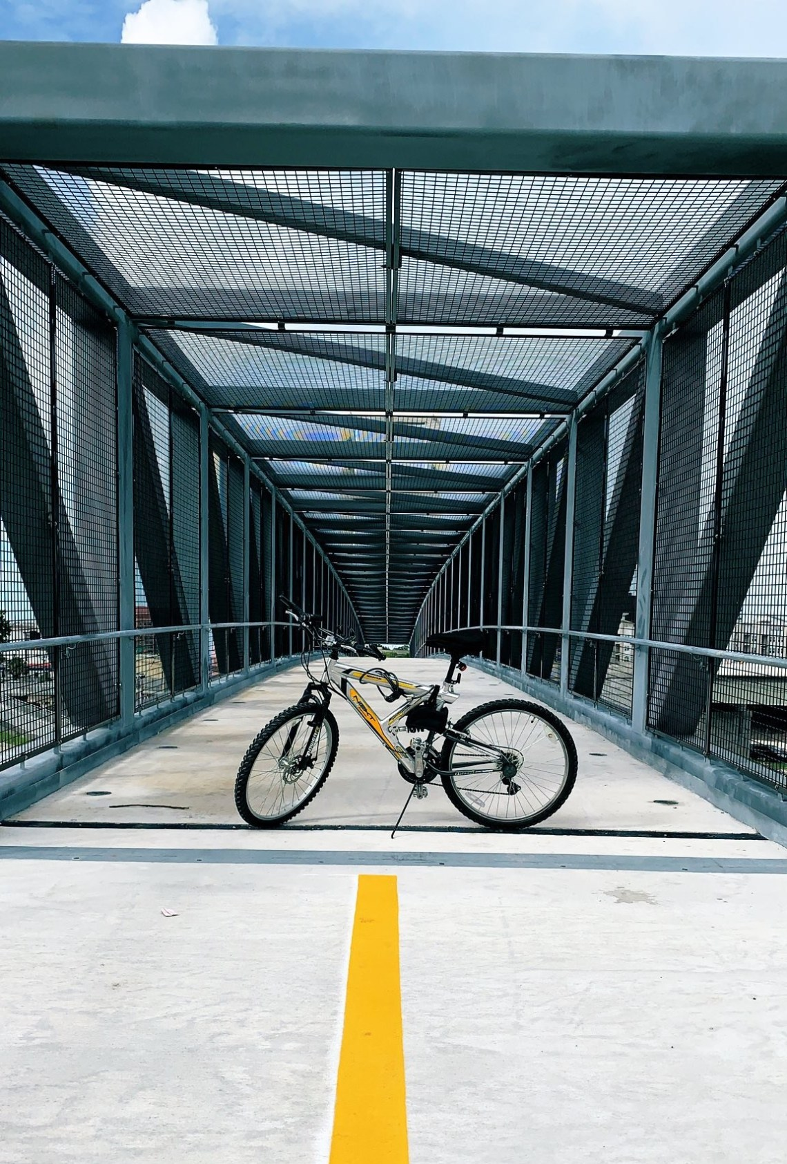 Mountain bike crossing a bridge in downtown Orlando for National Bike to Work Day.