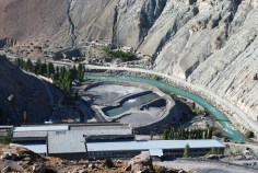 A hydropower station on Zaravshan River among the rocks