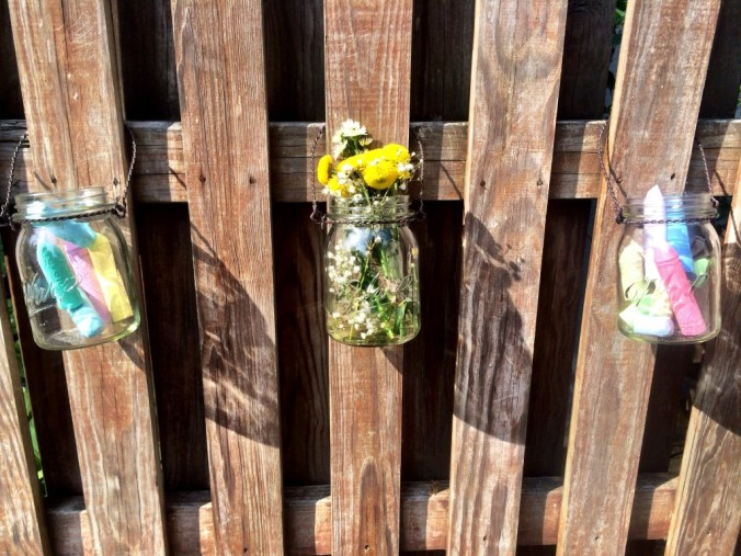 mason jars on fence