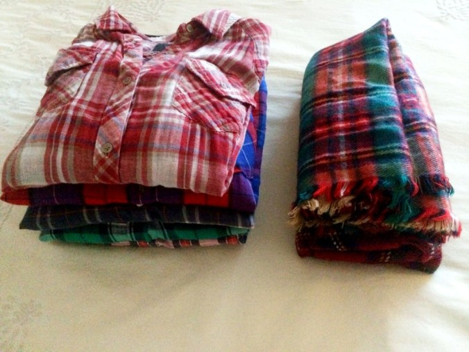 plaid pile of shirts and scarves