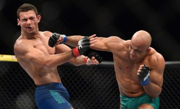 May 31, 2014; Sao Paulo, SP, BRAZIL; Marcio Alexandre Junior (red gloves) fights Warlley Alves (blue gloves) during the TUF Brazil 3 Finale at Ibirapuera Gymnasium. Mandatory Credit: Jason Silva-USA TODAY Sports