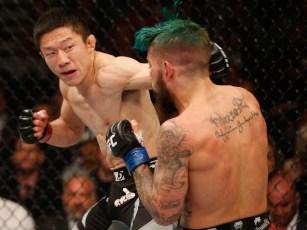 Kyoji-Horiguchi-punches-Louis-Gaudinot---Josh-Hedges-Zuffa-LLC