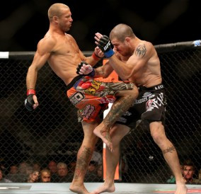 Jul 16, 2014; Atlantic City, NJ, USA; Donald Cerrone (red gloves) throws a knee at Jim Miller (blue gloves) during a 5-round lightweight bout at Revel Casino. Mandatory Credit: Bill Streicher-USA TODAY Sports