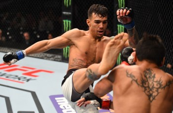MONTERREY, MEXICO - NOVEMBER 21: (L-R) Andre Fili of the United States kicks Gabriel Benitez of Mexico in their featherweight bout during the UFC Fight Night event at Arena Monterrey on November 21, 2015 in Monterrey, Mexico. (Photo by Jeff Bottari/Zuffa LLC/Zuffa LLC via Getty Images)