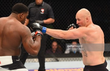 in their heavyweight bout during the UFC 197 event inside MGM Grand Garden Arena on April 23, 2016 in Las Vegas, Nevada.