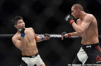 Feb 27, 2016; London, United Kingdom; Tom Breese (red gloves) competes against Keita Nakamura (blue gloves) during UFC Fight Night at O2 Arena. Mandatory Credit: Per Haljestam-USA TODAY Sports