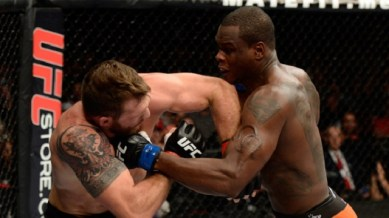 BANGOR, ME - AUGUST 16: (R-L) Ovince Saint Preux punches Ryan Bader in their light heavyweight bout during the UFC fight night event at the Cross Insurance Center on August 16, 2014 in Bangor, Maine. (Photo by Jeff Bottari/Zuffa LLC/Zuffa LLC via Getty Images)
