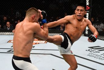 VANCOUVER, BC - AUGUST 27: (R-L) Enrique Barzola of Peru kicks Kyle Bochniak of the United States in their featherweight bout during the UFC Fight Night event at Rogers Arena on August 27, 2016 in Vancouver, British Columbia, Canada. (Photo by Jeff Bottari/Zuffa LLC/Zuffa LLC via Getty Images)