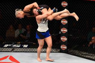 Jamie-Moyle-wrestling-Kailin-Curran-from-UFC-Facebook