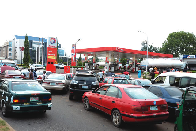 Image result for Tweet   Share  Pin it  +1 Motorist queue for fuel in Abuja... on Sunday. Photo: Olatunji Obasa