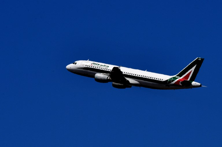 Image result for FILES) This file photo taken on May 3, 2017 shows a plane of Italian air company Alitalia from Rome's Fiumicino airport. A strike at Italian carrier Alitalia, placed in administration earlier this month, grounded 200 flights on May 28, 2017, the airline said, adding it managed to reassign some 80 percent of passengers affected. / AFP PHOTO / Alberto PIZZOLI