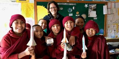Volunteer teacher with young nuns.