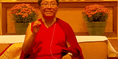 Rinpoche gesticulating.