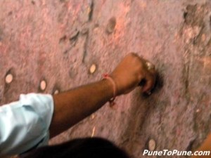 Sticking coins of belief
