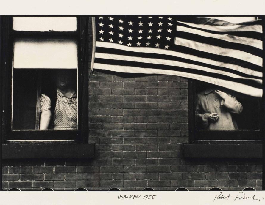 Robert Frank: Parade – Hoboken, New Jersey, 1955. © Christie's